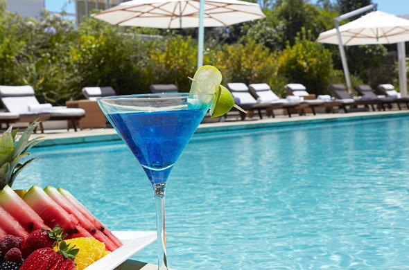 Enjoy a cocktail at the poolside.