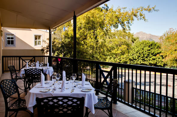 Dine on the balcony at Protea Hotel Franschhoek.