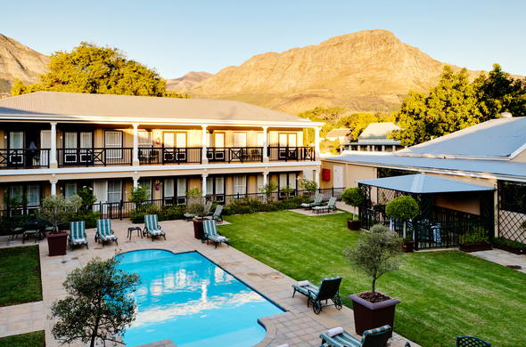 Swimming pool and comfortable lounges at Protea Hotel Franschhoek.